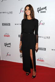 Carine Roitfeld went for minimalist elegance at the Fashion Media Awards in a structured black evening dress with a thigh-high slit.