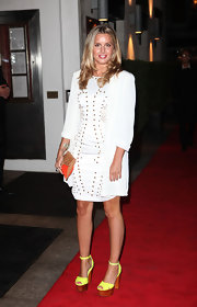 Caggie added a pop of color to her white dress with bright yellow platform sandals.