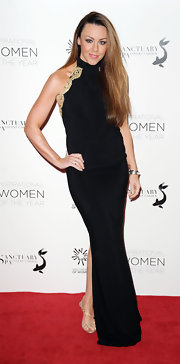 Michelle Heaton flaunted her curves in a black halter gown with neck-to-back gold lace trim.