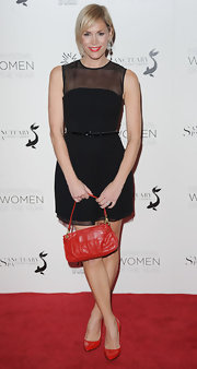 Jenni Falconer spiced up her belted black dress with a pair of pointy patent leather pumps.