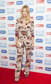 Laura Whitmore teamed her outfit with a simple white box clutch.