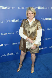 Martha Stewart got all glitzed up in a gold V-neck dress layered over a collared shirt for the DailyMail.com & Elite Daily holiday party.