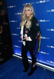 Kesha made Halloween look festive when she wore this pantsuit, featuring fringed sleeves and skull, star, rainbow, and heart embroidery, to DailyMail.com's Seriously Scary party.