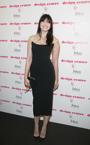 Daisy Lowe Tasselled Clutch [dress,clothing,cocktail dress,shoulder,little black dress,fashion,hairstyle,joint,fashion model,footwear,marilyn monroe,legacy of a legend,daisy lowe,legacy of a legend launch party at design centre,chelsea harbour,england,london,design centre,launch party]