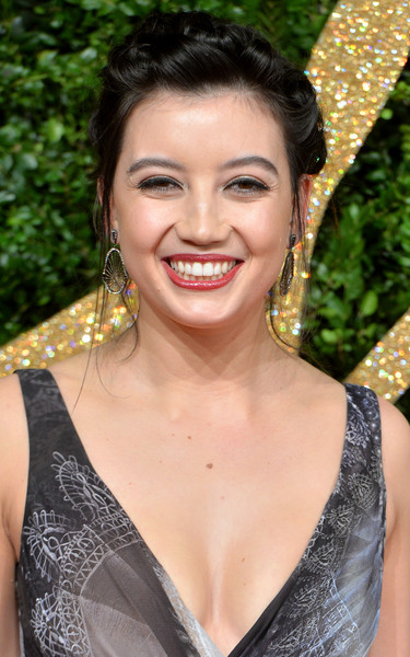 Daisy Lowe Dangling Diamond Earrings [hair,face,facial expression,eyebrow,hairstyle,beauty,lip,smile,skin,chin,daisy lowe,british fashion awards,london coliseum,england,red carpet arrivals]