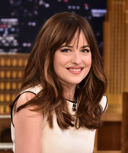 Dakota Johnson appeared on 'The Tonight Show' wearing a gently wavy hairstyle with wispy bangs.
