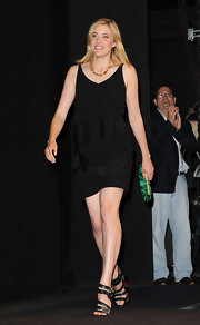 Greta Gerwig paired her LBD with black strappy sandals for a sexy finish.