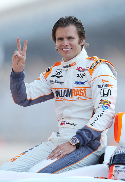 Dan Wheldon Gold Chronograph Watch [sports,vehicle,finger,sleeve,world,dan wheldon,photographers,william rast-curb,gestures,england,indianapolis motor speedway,indiana,honda,big machine dallara,indianapolis 500 mile race champions portrait session]