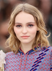 Lily-Rose Depp opted for casual shoulder-length waves when she attended the Cannes photocall for 'The Dancer.'