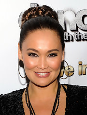 Tia Carrere hit the opening of 'Dancing With the Starts: Live in Las Vegas' wearing her silky locks in an elegant braided bun.
