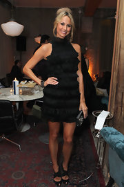 Stacy paired her ruffled black frock with a black and clear crystal clutch.