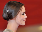 Keira Knightley's unique updo at 'A Dangerous Method' premiere is a great option for shorter hair lengths. Keeping tresses smooth and close the head, the ends are secured in a hair elastic, turned under and pinned into place. Decorative pins add a touch of whimsy.