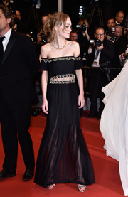 Lily-Rose Depp flashed some skin in an embellished black off-the-shoulder gown with a sheer skirt and a bare midriff during the Cannes premiere of 'I, Daniel Blake.'