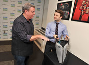 Elvis Duran kept it cool but stylish in a striped button-down with rolled-up sleeves.