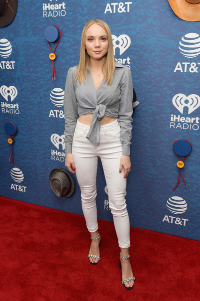 Danielle Bradbery Skinny Jeans [red carpet,clothing,carpet,denim,premiere,electric blue,flooring,jeans,outerwear,waist,danielle bradbery,use,austin,texas,frank erwin center,at t,red carpet,iheartcountry festival]
