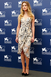 Amber Heard looked fetching in floral faux-wrap dress by Zimmermann during the Venice Film Fest photocall for 'The Danish Girl.'