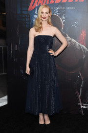 Deborah Ann Woll was a classic beauty in a strapless navy dress by Armani during the 'Daredevil' season 2 premiere.