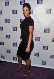 Nicole shows off her curves in a slim fitting LBD.