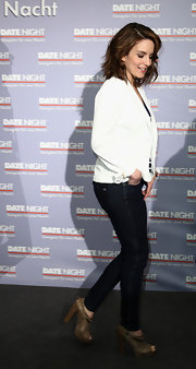 Tina dressed up her skinny jeans with a pair of peep-toed tan ankle boots. The chunky heels were semi-casual and perfect for the light-hearted film's event.