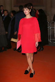 Pixie Geldof opted for this red hippie-inspired frock with fringe sleeves for her '70s red carpet look.