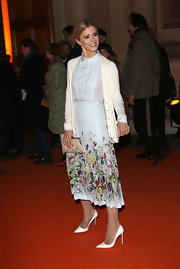 Laura Bailey looked prim and proper in her floral frock with pleats at the 'David Bowie Is' red carpet.