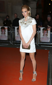 Vanessa Kirby sported a white cocktail dress with an embellished collar for her red carpet look.