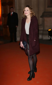 Laura Carmichael wore a classic burgundy coat for her red carpet look.