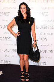 A pair of black strappy sandals added a sexy-edgy touch to Megan Gale's look.