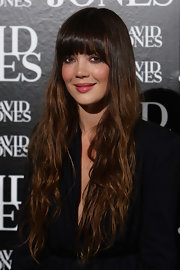 Emma's long curly locks looked perfectly polished. Wispy bangs put the finishing touch on her radiant look.
