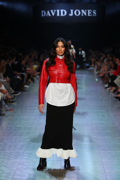 Jessica Gomes walked the David Jones Gala Runway Show wearing a fitted red leather jacket over a white blouse.