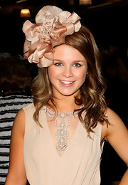 Emma Freedman gave her nude dress added interest with a matching floral headband.