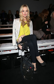 Laura Whitmore complemented her outfit with a tote in a subtle leopard print when she attended the David Koma fashion show.