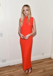 Portia Doubleday paired her dress with gold platform sandals by Casadei.