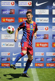 Spanish Footballer David Villa wears blue soccer socks by Nike.