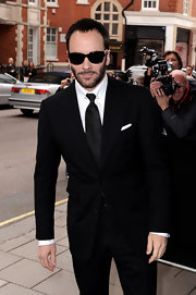 Tom Ford is badass-chic in jet-black shades.