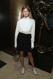 Constance Jablonski balanced out her boyish top with a fluted black mini skirt.