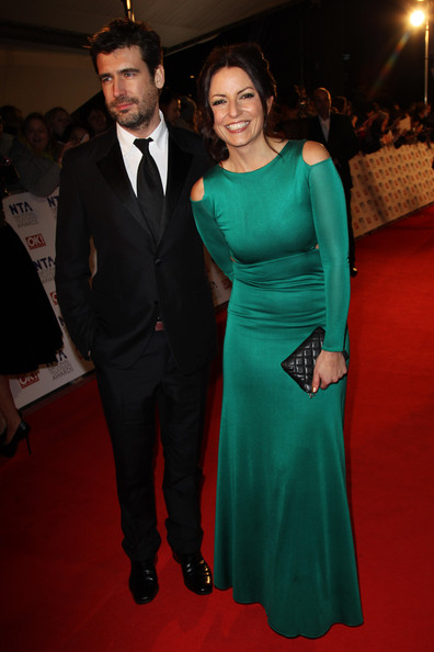 Davina McCall Quilted Clutch [carpet,red carpet,dress,formal wear,fashion,event,flooring,premiere,suit,gown,indigo,inside arrivals,davina mccall,national television awards,uk,london,england,the o2 arena,tabloid newspapers]
