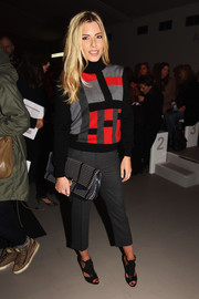 Mollie King chose gray capri pants to pair with her sweater.