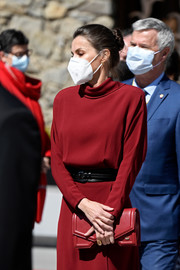 Queen Letizia of Spain carried a stylish red leather clutch by Reliquiae while touring Andorra.