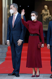 Queen Letizia of Spain matched burgundy pumps with a midi dress and clutch for her trip to Andorra.