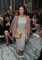 Michelle Keegan arrived for the Julien Macdonald fashion show wearing a mauve tweed coat over a pencil dress.