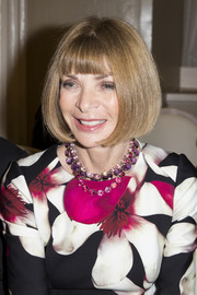 Anna Wintour accessorized her floral dress with layers of gemstone necklaces for an ultra-ladylike feel during London Fashion Week.
