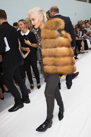 Rita Ora arrived for the Hunter Original fashion show wearing a glamorous fur coat over menswear-inspired separates.