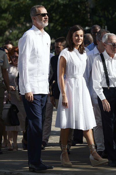 Queen Letizia of Spain kept it breezy in a white eyelet shirtdress by Adolfo Dominguez while touring Havana, Cuba.