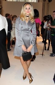 Pixie Lott went for classic sophistication in a double-breasted gray silk coat during the Temperley London fashion show.
