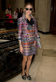 Olivia Palermo attended London Fashion Week looking vibrant in her mixed-pattern coat.