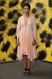 Golshifteh Farahani chose a caped, handkerchief-hem pink dress for the Locarno Film Festival photocall for 'The Song of Scorpions.'