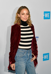 Nicole Richie layered a black-and-white striped turtleneck under a burgundy velvet coat for WE Day California.