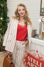 Natalie Dormer's red cami added a sexy touch to her suit at the Championships, Wimbledon event.