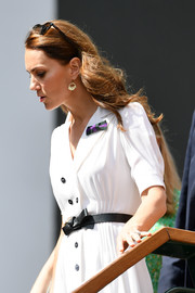 Kate Middleton styled her dress with a bowed leather belt by Alexander McQueen for day two of Wimbledon 2019.
